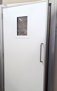Personnel door with flush vision panel
